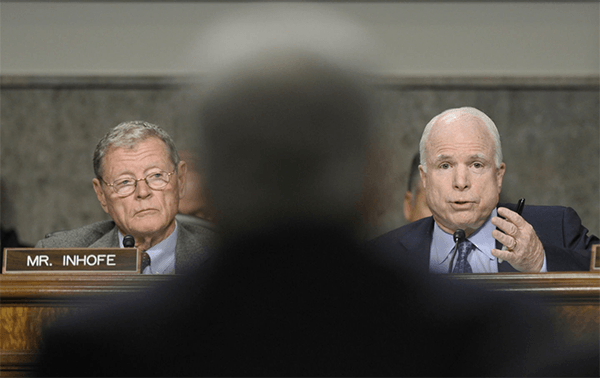 Senator James Inhofe, left, and Senator John McCain, right, of the Senate Armed Services Committee. (AP Photo/Susan Walsh)