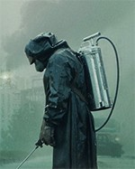 Person in protective clothing with a spray pack on their back